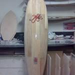 Planche de surf customisée avec le poulpe-fraise